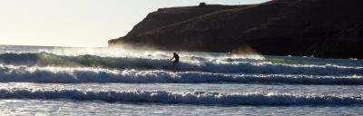 Image of farmer surfing the waves.
