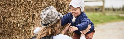 image of toddler and mother on-farm